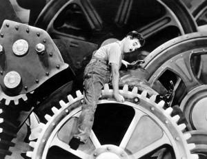 """Charles Chaplin en la película """"Tiempos Modernos"""""""